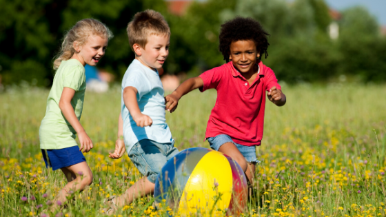 Children playing in a field.